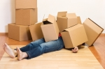 Man covered in cardboard boxes – movingconcept