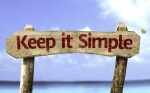 Keep It Simple sign with a beach onbackground